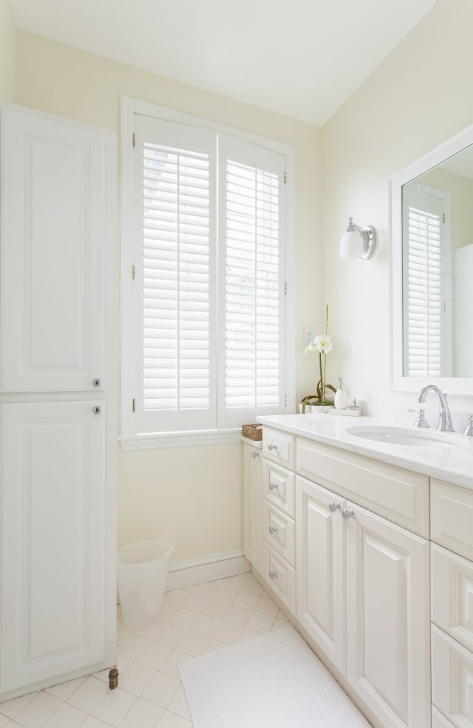 white bathroom with large window