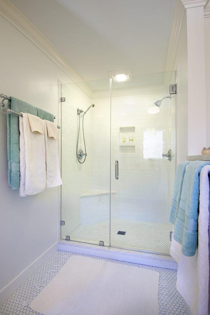 white bathroom with frameless glass shower